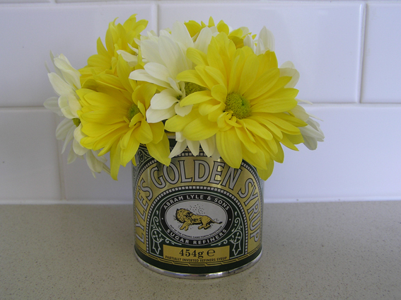This has got nothing to do with anything. I just like putting daisies in a  golden syrup tin.